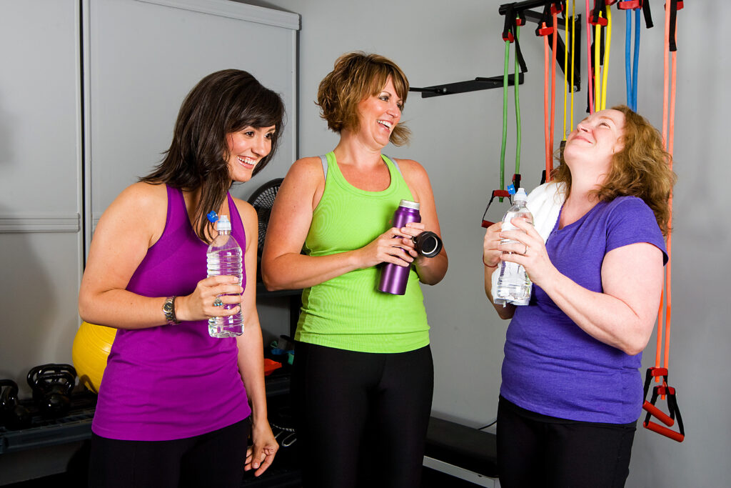 happiness and fitness - a group of happy women post exercise