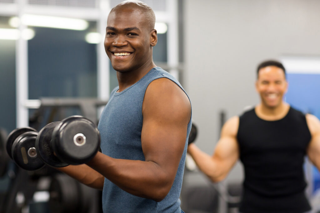 healthy happy man working out in the gym
