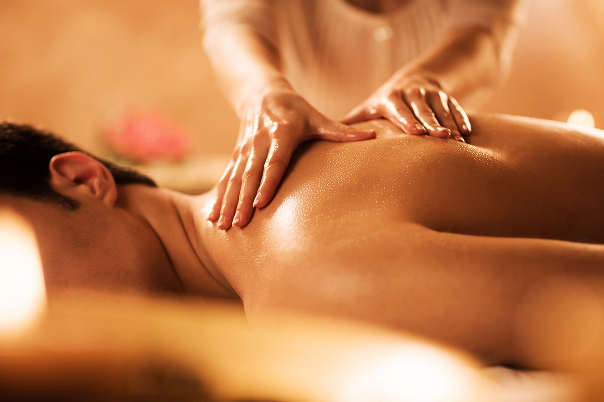 Man receiving a swedish massage at spa