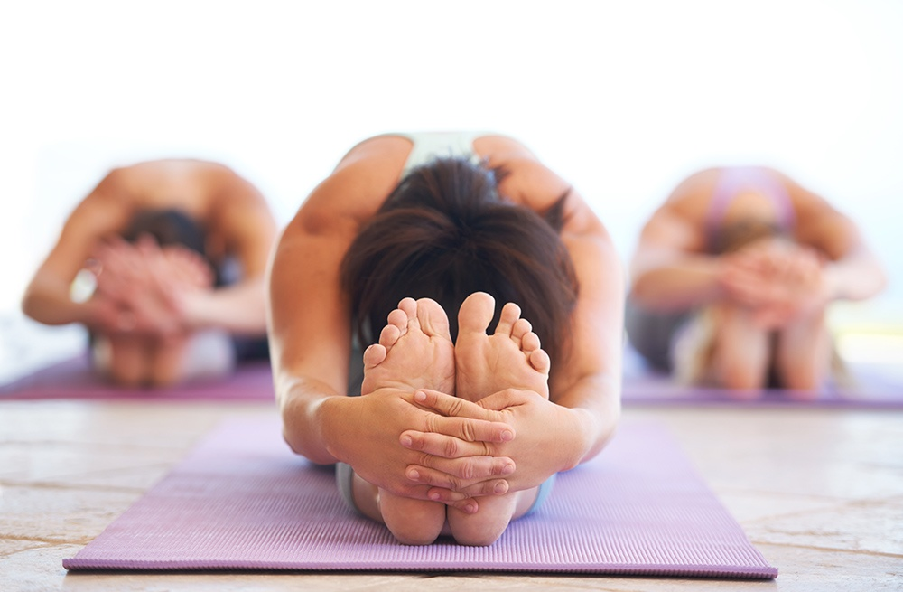 Touching toes is a great goal when learning yoga.