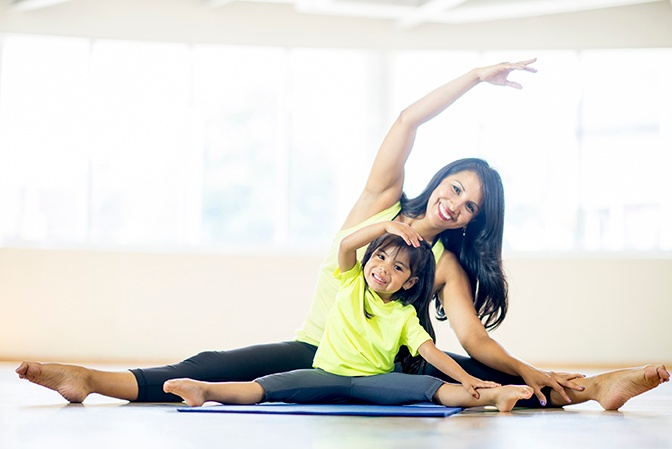 Mom and duaghter floor exercise