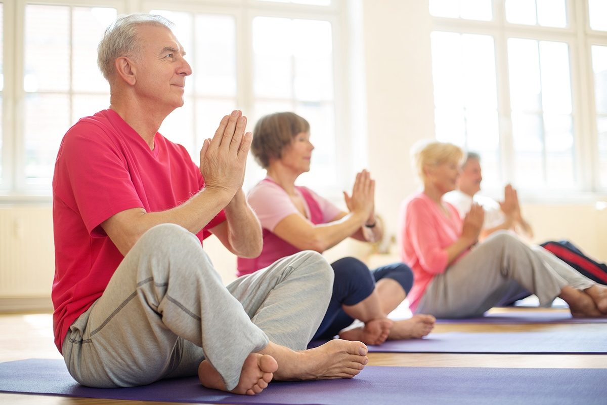 Senior man at yoga class