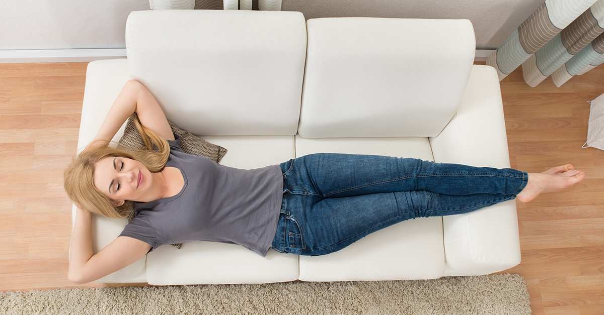 Woman sleeping on couch being lazy