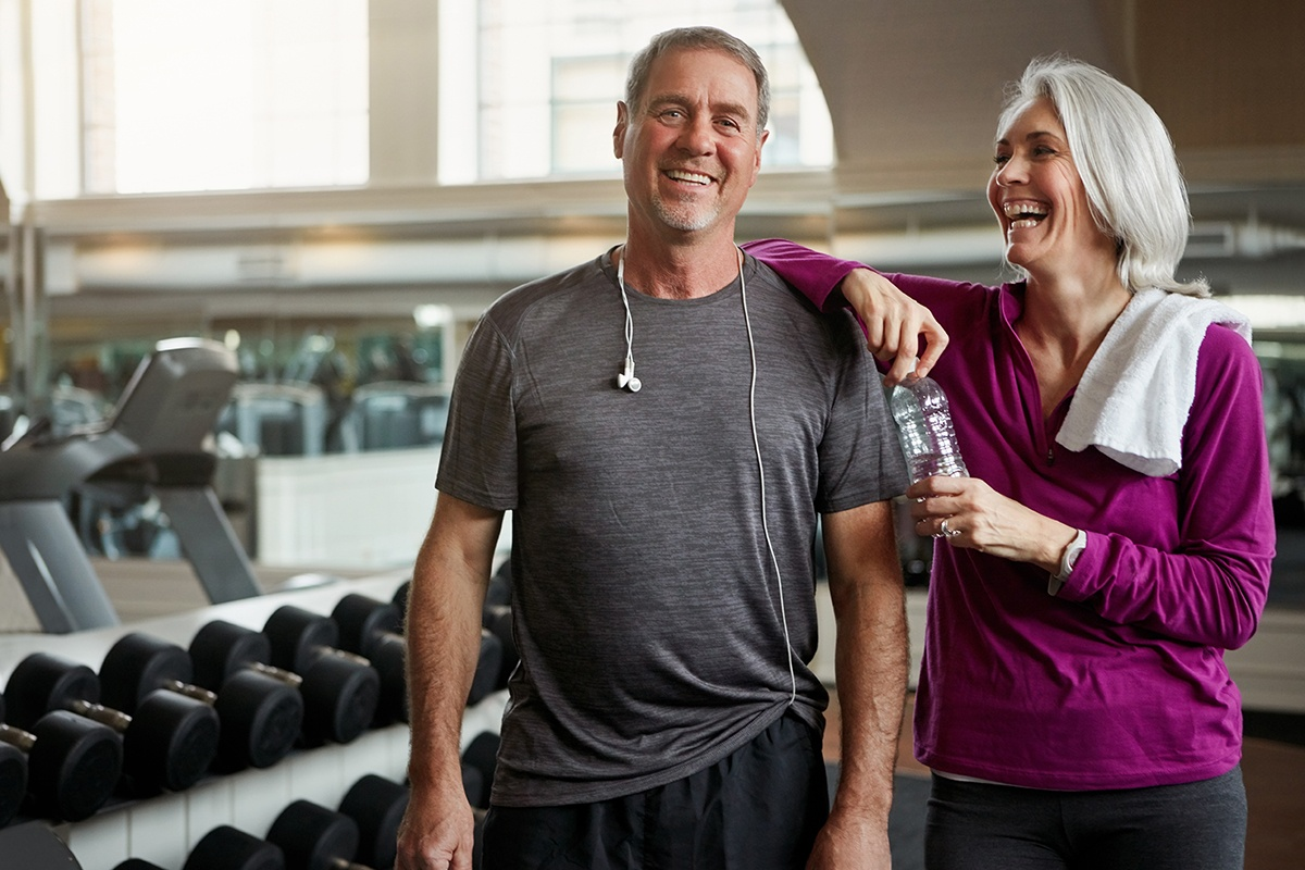 Middle aged healthy couple at gym