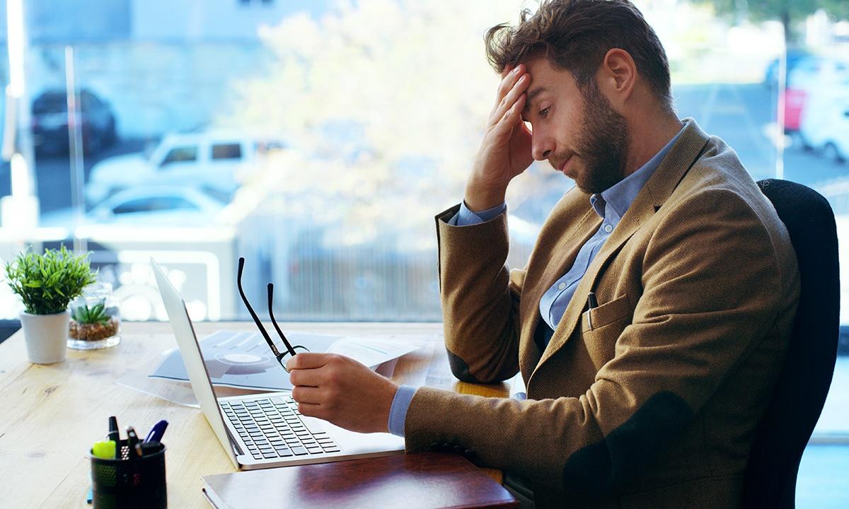Man feeling stress at work