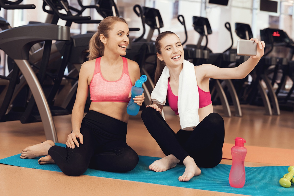 personal happiness - Friends taking selfie at gym