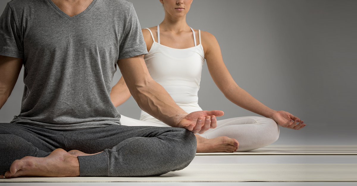 Man and woman meditating