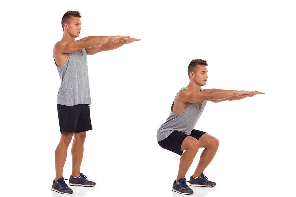 Man doing sit to stand strength evaluation.